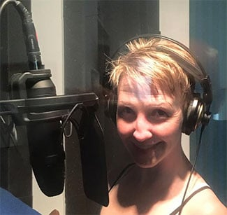Judy with mic for web.jpg