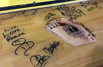 autographs on the bar at the Hub Cafe from years gone by - for web.jpg